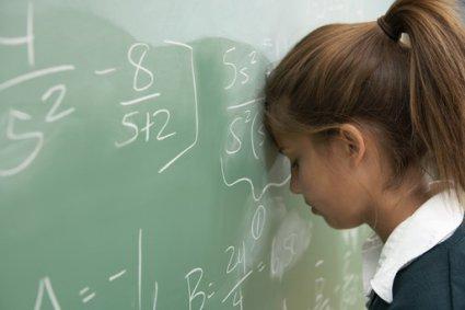 126_child-adhd-girl-at-blackboard